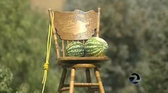 Photo Empty Chair, Watermelon, and Noose