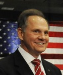 Photo of Moore with US flag in background