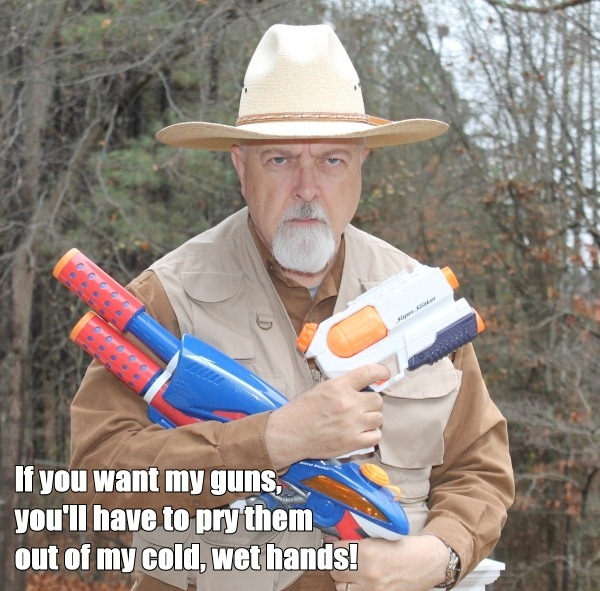 Photo of Dr. Conspiracy holding water pistols