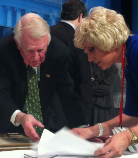 Orly Taitz shows papers to Edwin Meese