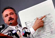Photo of Mike Zullo holding enlarged Obama Long Form birth certificate