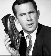 Secret agent Maxwell Smart holding a shoe phone