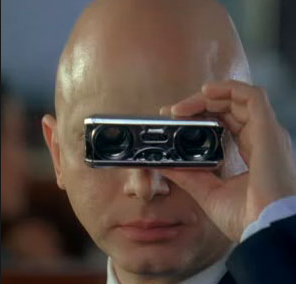 Observer character (bald man in black suit using opera glass) from the Fringe TV series