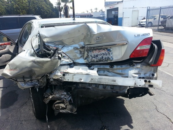 Taitz accident photo showing extensive rear end damage