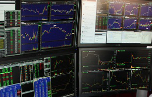 4 computer monitors with day trading software