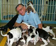 photo of Joe Arpaio with dogs in front of cell door